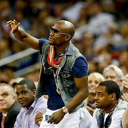 Nov 2, 2013; New Orleans, LA, USA; Professional boxer and entertainer Floyd Mayweather Jr courtside during the second half of a game between the New Orleans Pelicans and the Charlotte Bobcats at New Orleans Arena. The Pelicans defeated the Bobcats 105-84. Mandatory Credit: Derick E. Hingle-USA TODAY Sports