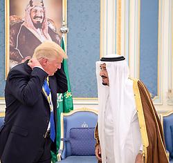 Saudi King Salman Bin Abdelaziz (or Abdul Aziz) Al Saud (right) awards US President Donald Saudi Arabia's highest civilian honor, the gilded Collar of 'Abdulaziz al Saud', during a ceremony at Royal Palace, in Riyadh, Saudi Arabia on May 20, 2017. This is the first US president's visit abroad. Photo by Balkis Press/ABACAPRESS.COM