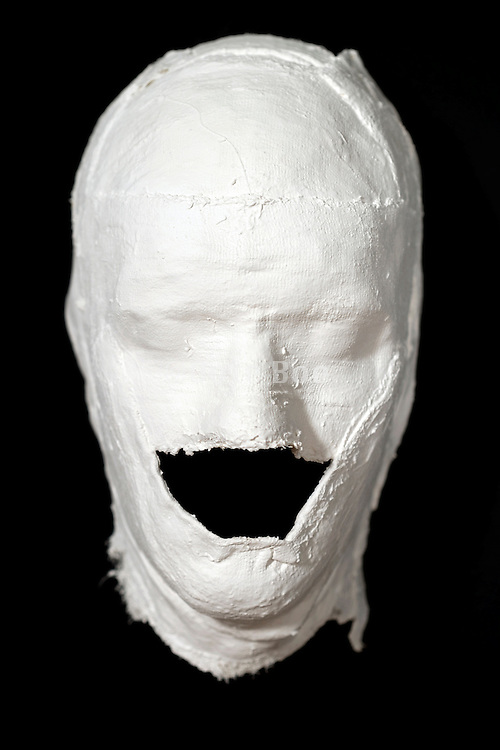 mask of plaster with closed eyes