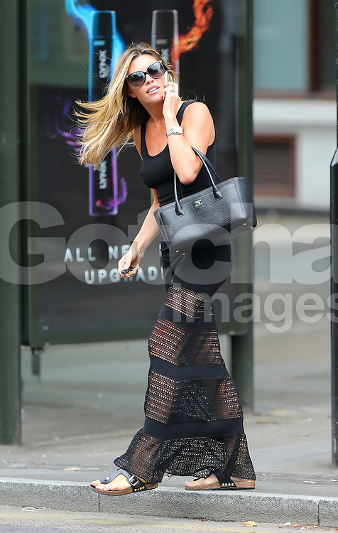 Model Abbey Clancy looking stunning wearing a black maxi dress, sandals and carring Chanel handbag out running errands in London, UK. 25/07/2014<br />BYLINE MUST READ : JAMESY/GOTCHA IMAGES<br /><br />Copyright by © Gotcha Images Ltd. All rights reserved.<br />Usage of this image is conditional upon the acceptance <br />of Gotcha Images Ltd, terms and conditions available at<br />www.gotchaimages.com