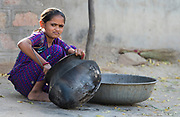Young girl preparing food in Chanoud, Rajasthan, India.