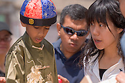 1824825th Annual International Street Fair.Virak Kruy, leading..Ishan Matta, Vic Matta(dad) & Novia Chen, Play Pinball