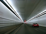 Traffic moves through the Eisenhower Tunnel on Interstate 70 in Colorado. The tunnel is the highest vehicular tunnel in the world with an average elevation of 11,112 feet. The tunnel passes through the Continental Divide. (Photo by Kevin Bartram)