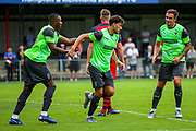 Goal AFC Wimbledon defender Will Nightingale (5) scores a goal and celebrates 0-1during the Pre-Season Friendly match between Hampton & Richmond and AFC Wimbledon at Beveree Stadium, Richmond Upon Thames, United Kingdom on 27 July 2019.