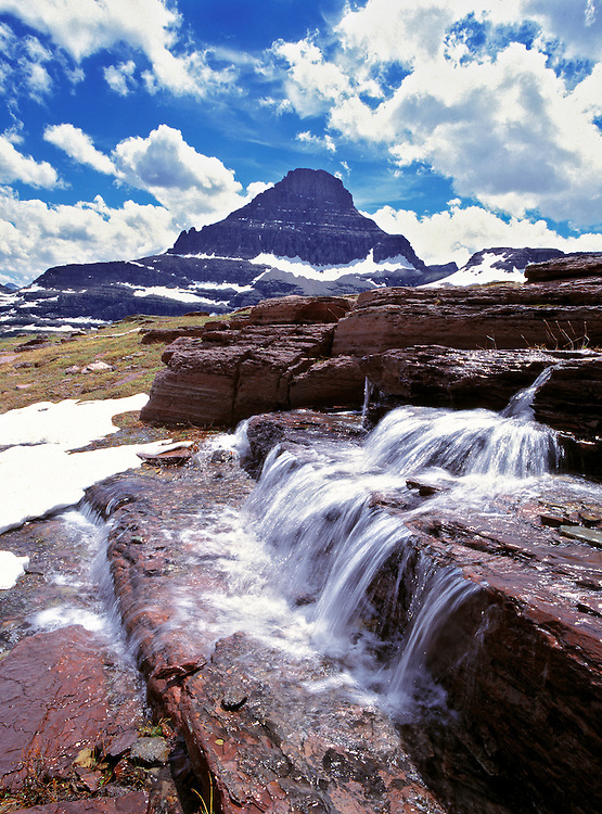 A small waterfall flows near the Logan Pass Visitors Center in Glacier National Park, Montana.