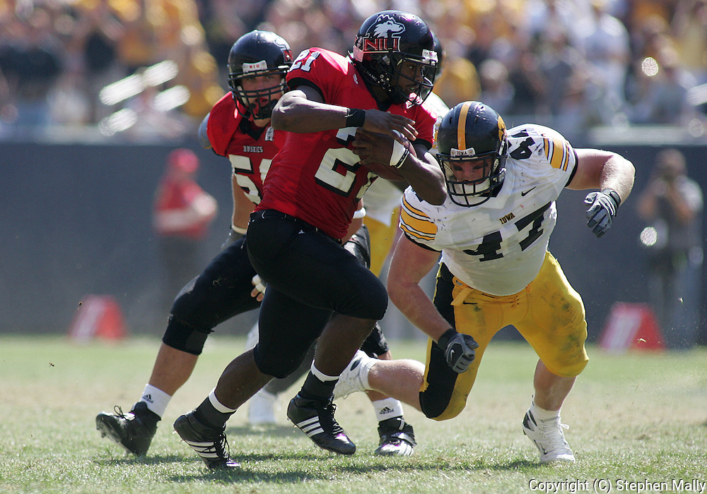 01 SEPTEMBER 2007: Northern Illinois tailback Justin Anderson (21) tries to avoid Iowa defensive tackle Mitch King (47) in Iowa's 16-3 win over Northern Illinois at Soldiers Field in Chicago, Illinois on September 1, 2007.