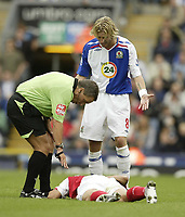 Photo: Aidan Ellis.<br /> Blackburn Rovers v Arsenal. The FA Barclays Premiership. 19/08/2007.<br /> Blackburn's Robbie Savage moans to the ref as Arsenal's Eduardo lays injured supposedly