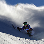 Peter Dunning, Great Britain, loses control momentarily during the Men's Giant Slalom Sitting, Adaptive competition at Coronet Peak, New Zealand during the Winter Games. Dunning, who lost both his legs in a roadside bombing attack in Afghanistan three years ago. Winter Games, Queenstown, New Zealand, 25th August 2011. Photo Tim Clayton..