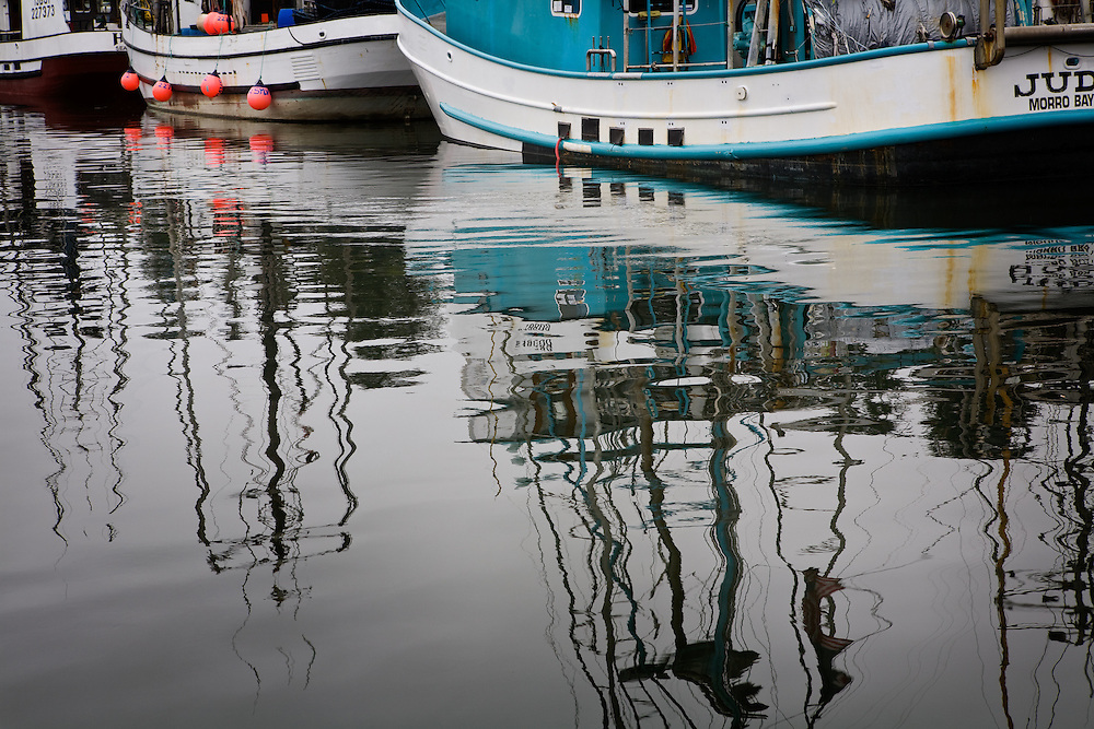 Reflections in the harbor at Yaquina Bay in Newport, Oregon.