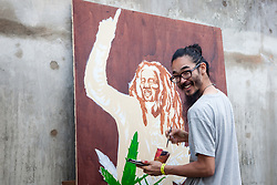 Artist Noa- (noahyphen) paints a portrait of Bob Marley.  20th Annual Bordeaux Farmers Rastafari Agricultural & Cultural Vegan Food Fair.  Bordeaux Farmers Market.  St. Thomas, USVI.  14 January 2017.  © Aisha-Zakiya Boyd