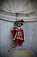 Manneken Pis, Brussels famous peeing boy statue is dressed for the Ommegang festival in Brussels, Belgium.