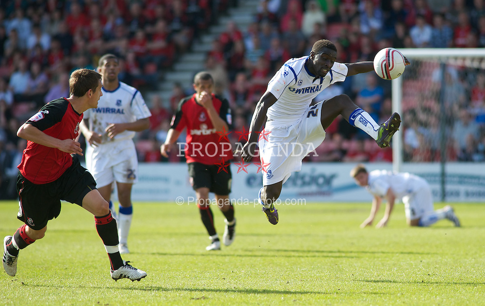 BOURNEMOUTH, ENGLAND - Saturday, April 9, 2011: Tranmere Rovers' Zoumana Bakayogo jumps through the air to get the ball during the Football League One match at the Dean Court Stadium. (Photo by Gareth Davies/Propaganda)