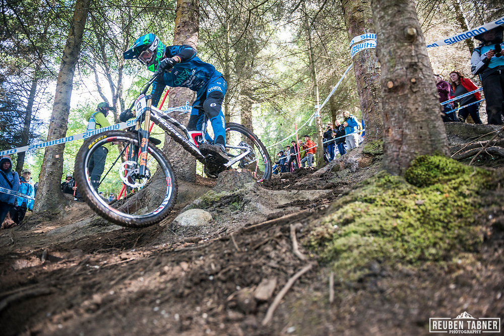 Greg Minnaar finding his way in through the woods during his qualifying round at the UCI Mountain Bike World Cup in Fort William, Scotland.