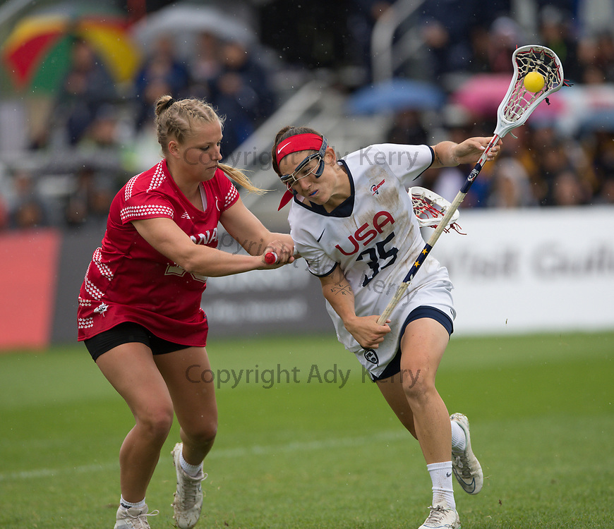 USA's Michelle Tumolo is challenged by Canada's Kay Morissette during the gold medal match at the  2017 FIL Rathbones Women's Lacrosse World Cup, at Surrey Sports Park, Guildford, Surrey, UK, 22nd July 2017.