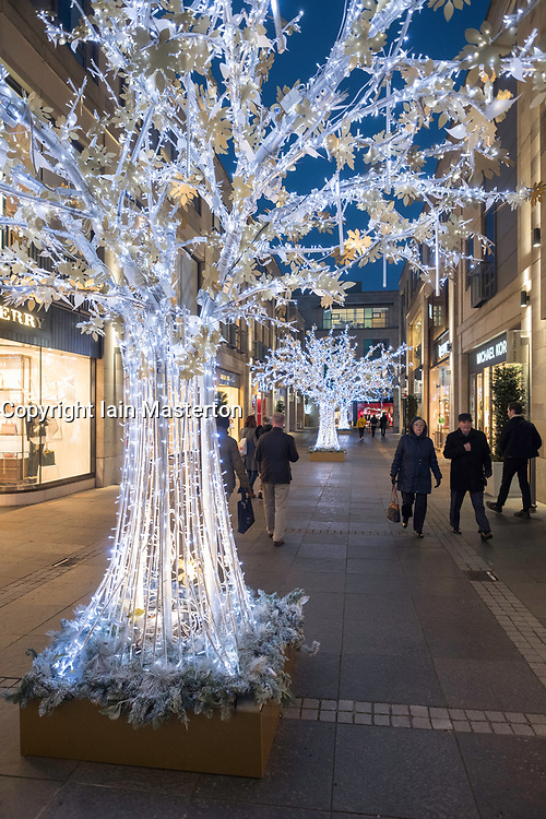 Night view of Christmas decorations and lights on Multrees Walk upmarket shopping arcade in Edinburgh, Scotland, United Kingdom