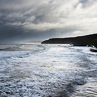Waves Breaking on the Shore at High Tide in the South Bay in Winter Scarborough North Yorkshire England