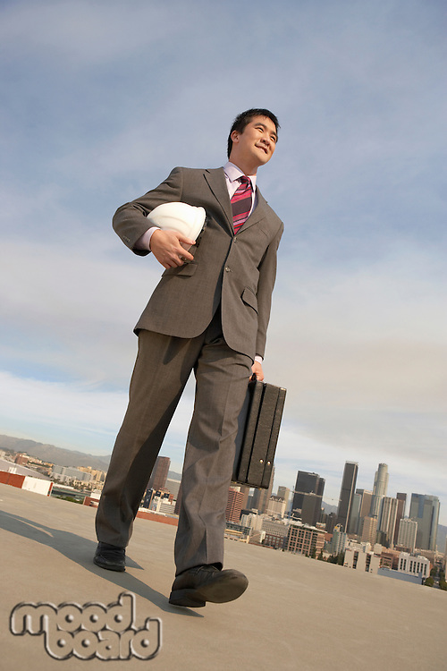 Businessman Carrying a Hard Hat
