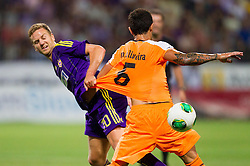 Goran Cvijanovic #20 of Maribor vs Marcelo Oliveira of Apoel during football match between NK Maribor and APOEL FC, (Cyprus) in Third qualifying round, Second leg of UEFA Champions League 2014, on August 6, 2013 in Stadium Ljudski vrt, Maribor, Slovenia. (Photo by Vid Ponikvar / Sportida.com)