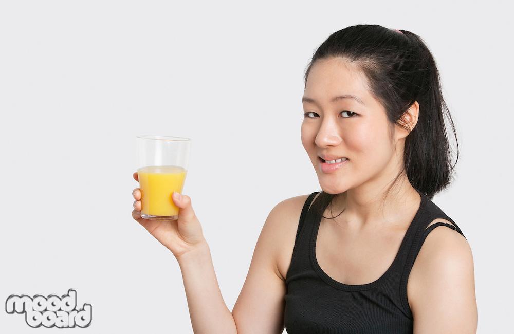 Portrait of a beautiful woman having a glass of orange juice