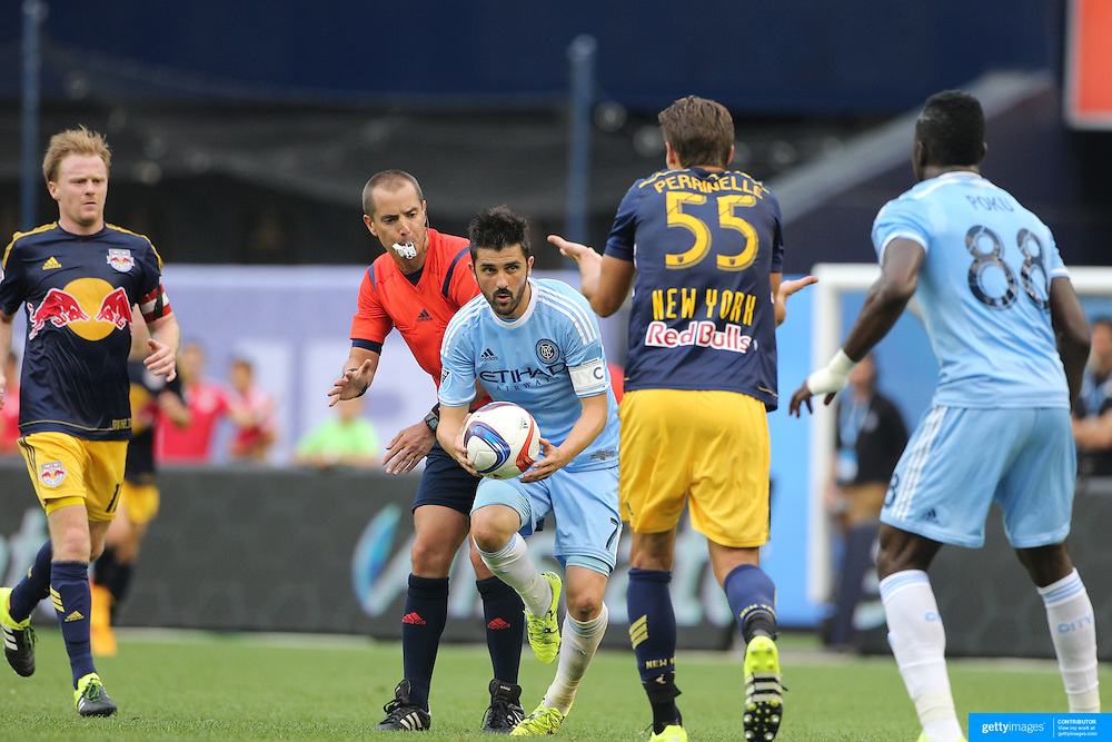 David Villa, NYCFC, attempts to take a free kick quickly during the New York City FC Vs New York Red Bulls, MSL regular season football match at Yankee Stadium, The Bronx, New York,  USA. 28th June 2015. Photo Tim Clayton