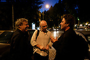 "French musicians Michel Portal, Sebastian Boisseau and Louis Sclavis chat on the street after their concert with swiss drumer Daniel Humair held at Coimbra Jazz festival ""Jazz ao Centro""."