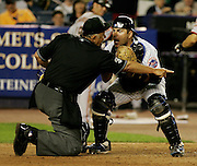 New York Mets'catcher, Paul LoDuca argues with home plate umpire, Randy Marsh over his call safe of San Francisco Giants' Omar Vizquel in the 12 th inning at Shea Stadium in Flushing, N.Y.