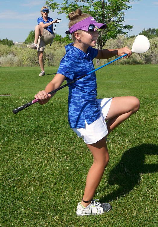 gbs071617b/SPORTS -- Kathy Janke, left, and 12-year-old Avery Sky, stretch out after waiting behind several groups to tee off at the Chenna 2 hole during the NM-WTexas/City Women's Championship at the Santa Ana golf Course on Sunday, July 16, 2017. (Greg Sorber/Albuquerue Journa)
