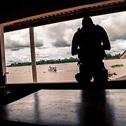 Guajarà-Mirim. A Brazilian soldier patrolling at the ferry pier river crossing between Brazil and Bolivia