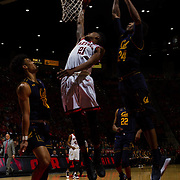 09 December 2017:  The San Diego State men's basketball team hosts the California Golden Bears Saturday afternoon. San Diego State Aztecs forward Malik Pope (21) attempts a lay-up on a break away play in between two Cal defenders. The Aztecs lost 63-62 to Cal.<br /> www.sdsuaztecphotos.com
