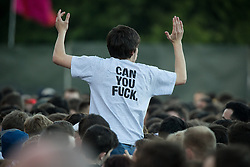 """© Licensed to London News Pictures . 05/06/2015 . Manchester , UK . Courteeners fan with """" Can you fuck """" t-shirt in the crowd . Evening concerts featuring headliners , The Courteeners , playing a homecoming gig , at Heaton Park in Manchester in front of 25,000 people , the evening before the Parklife music festival . Photo credit : Joel Goodman/LNP"""