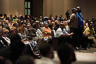 Joshua Taylor and his father, Adrian Taylor, stand during a memorial service for Christian Taylor at Cornerstone Baptist Church in Arlington, Texas on August 12, 2015. (Cooper Neill for The New York Times)