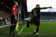 Swansea City midfielder Matt Grimes (8) takes a corner, Assistant Referee Darren Cann looks on, during the EFL Sky Bet Championship match between Queens Park Rangers and Swansea City at the Kiyan Prince Foundation Stadium, London, England on 21 August 2019.