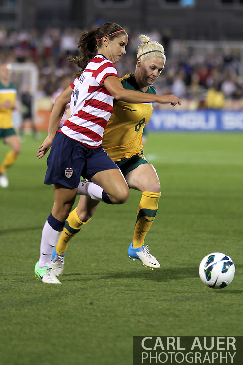 September 19, 2012 Commerce City, CO.  USA f Alex Morgan (13) tries to out run Australia d Danielle Brogan (8) during the Soccer Match between the USA Women's National Team and the Women's Australian team at Dick's Sporting Goods Park in Commerce City, Colorado