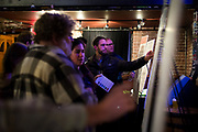 "Panel discussion attendees examine interactive boards following the talk: ""How can Madison build more great neighborhoods?"" at High Noon Saloon in Madison, Tuesday, November 7, 2017."