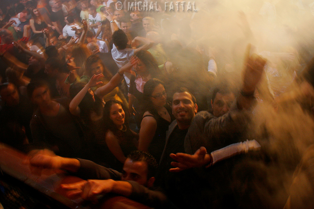 Israeli clubbers dance during a trance party of the international Israeli trance DJ Skazy, in a club called Haoman 17 in Jerusalem, January 2007.