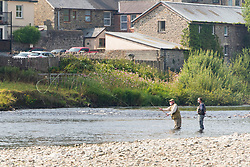© Licensed to London News Pictures. 11/08/2020. Builth Wells, Powys, Wales, UK. Angling tuition takes place on a hot morning on the River Wye at Builth Wells in Powys,Wales, UK. Photo credit: Graham M. Lawrence/LNP