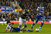 Duane Holmes (23) of Derby County is tackled by Ovie Ejaria (14) of Reading during the EFL Sky Bet Championship match between Reading and Derby County at the Madejski Stadium, Reading, England on 21 December 2019.