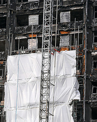 October 14, 2017 - London, United Kingdom - Work Begins To Cover Grenfell Tower. Scaffolding has been put up alongside Grenfell Tower in west London in preparation for a white sheet covering to shield its view from the public. Around 80 people died and hundreds were left homeless during the disaster on 14 June 2017, four months ago. Investigators will remove remnants of the cladding, which fuelled the fire on the tower block. (Credit Image: © Dinendra Haria/i-Images via ZUMA Press)