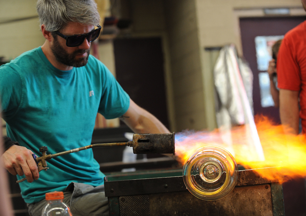 A professional glassblower teaches a hands on session in the glass studio during the Kent/Blossom Summer Art program.
