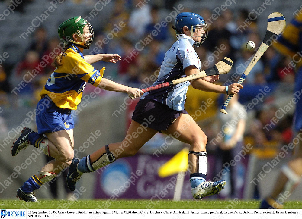 18 September 2005; Ciara Lucey, Dublin, in action against Moira McMahon, Clare. Dublin v Clare, All-Ireland Junior Camogie Final, Croke Park, Dublin. Picture credit; Brian Lawless / SPORTSFILE *** Local Caption *** Any photograph taken by SPORTSFILE during, or in connection with, the 2005 Guinness All-Ireland Hurling Final which displays GAA logos or contains an image or part of an image of any GAA intellectual property, or, which contains images of a GAA player/players in their playing uniforms, may only be used for editorial and non-advertising purposes.  Use of photographs for advertising, as posters or for purchase separately is strictly prohibited unless prior written approval has been obtained from the Gaelic Athletic Association.