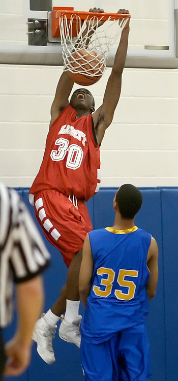 Liberty's Jermaine Ferguson (30) dunks the ball as Chapel Field's Peter Mulhare looks on during a game in Chester on Dec. 29, 2006.
