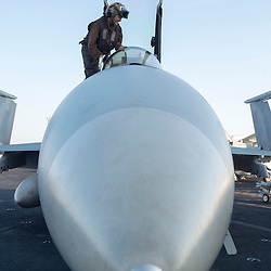 USS John C Stennis CVN-74 Aircraft Carrier.Pic Shows Flight and Hangar Deck personnel preparing aircraft for take off