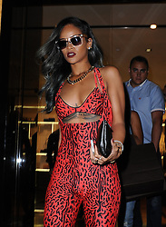 Rihanna wearing a red leopard print catsuit steps out in London to visit Roberto Cavali Store in Knightsbridge where she had a private shop for 4 hours. London, UK. 19/07/2013<br />BYLINE MUST READ : GOTCHAIMAGES.COM<br /><br />Copyright by © Gotcha Images Ltd. All rights reserved.<br />Usage of this image is conditional upon the acceptance <br />of Gotcha Images Ltd, terms and conditions available at<br />www.gotchaimages.com