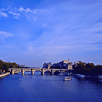 The Pont Neuf on an autumn  afternoon in Paris spanning the Seine and connecting the Left Bank to the Right Bank. The oldest bridge in Paris on the Seine. The Vert Galant is seen on the right one of Paris's most romantic spots.