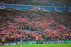 """LIVERPOOL, ENGLAND - Tuesday, April 24, 2018: Liverpool supporters in the Anfield Road stand hold up their scarves as they sing """"You'll Never Walk Alone"""" before the UEFA Champions League Semi-Final 1st Leg match between Liverpool FC and AS Roma at Anfield. (Pic by David Rawcliffe/Propaganda)"""