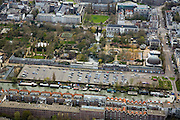 Nederland, Amsterdam, Plantage, 16-04-2008; Entrepodok (onder in beeld) en parkeerterrein voor Artis; rechts de Plantage Kerklaan met de koepel van het planetarium van Artis, daarnaast de ingang van de dierentuin; op tweederde - boven de tuin - de Plantage Middenlaan (met links van het midden St. Jacob (bejaardenhuis en verzorgingshuis / verpleegtehuis) en rechts - bij het kruispunt het gebouw wat de Koningszaal en Studio plantage huisvest;..luchtfoto (toeslag); aerial photo (additional fee required); .foto Siebe Swart / photo Siebe Swart