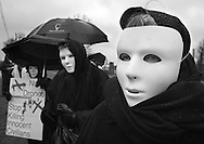 HORSHAM, PA - MARCH 29:  Marge Van Cleef (R) along with members of Coalition for Peace Action protest the Horsham Drone Command Center to protest March 29, 2014 in Horsham, Pennsylvania. The mask represents civilians that have been killed by drone strikes. (Photo by William Thomas Cain/Cain Images)