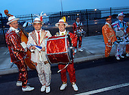 PHILADELPHIA - MARCH 21: A group of Mummers string band members pose for photos in front of Veteran's Stadium, the former home of the Philadelphia Phillies is imploded to make way for a parking lot March 21, 2004 in Philadelphia, Pennsylvania. The Philadelphia Phillies new hone, Citizen's Bank Park will open next to where Veteran's Stadium stood in April. (Photo by William Thomas Cain/Getty Images)