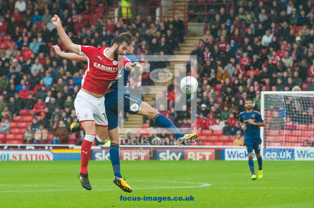 Adam Jackson of Barnsley in an aerial challenge with Markus Henriksen of Hull City during the Sky Bet Championship match at Oakwell, Barnsley<br /> Picture by Matt Wilkinson/Focus Images Ltd 07814 960751<br /> 21/10/2017