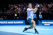 Roger Federer prepares to hit a backhand slice during the Andy Murray Live event at SSE Hydro, Glasgow, Scotland on 7 November 2017. Photo by Craig Doyle.